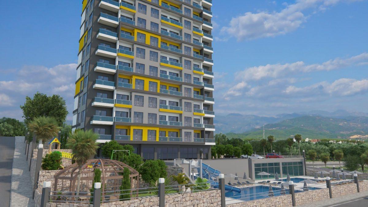Высотный жилой комплекс в живописном районе Махмутлар  - Фото 2