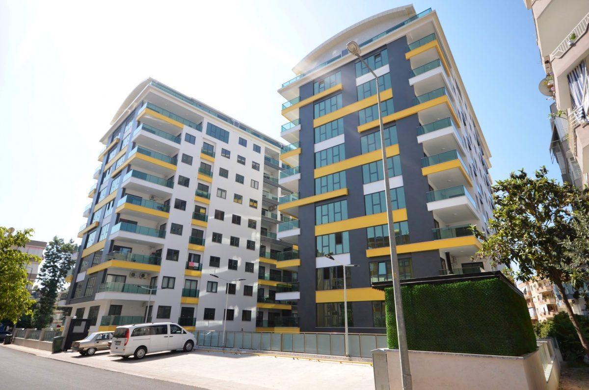 Четырехкомнатные апартаменты в центре Алании, рядом с популярными торговыми центрами  - Фото 1