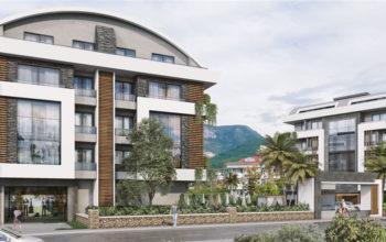 Новый жилой комплекс в окружении  апельсиновых деревьев
