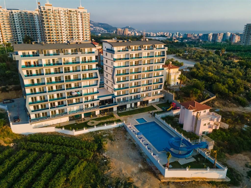 Жилой комплекс в стремительно развивающемся районе Махмутлар - Фото 2
