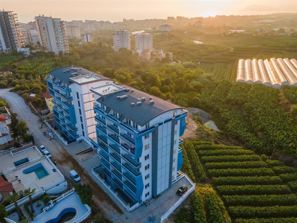 Жилой комплекс в стремительно развивающемся районе Махмутлар - Фото 4