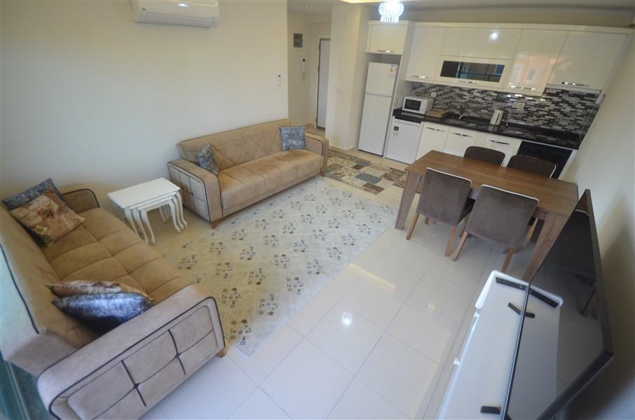 Просторная меблированная квартира 1+1 в Махмутларе в 250 метрах от моря - Фото 4