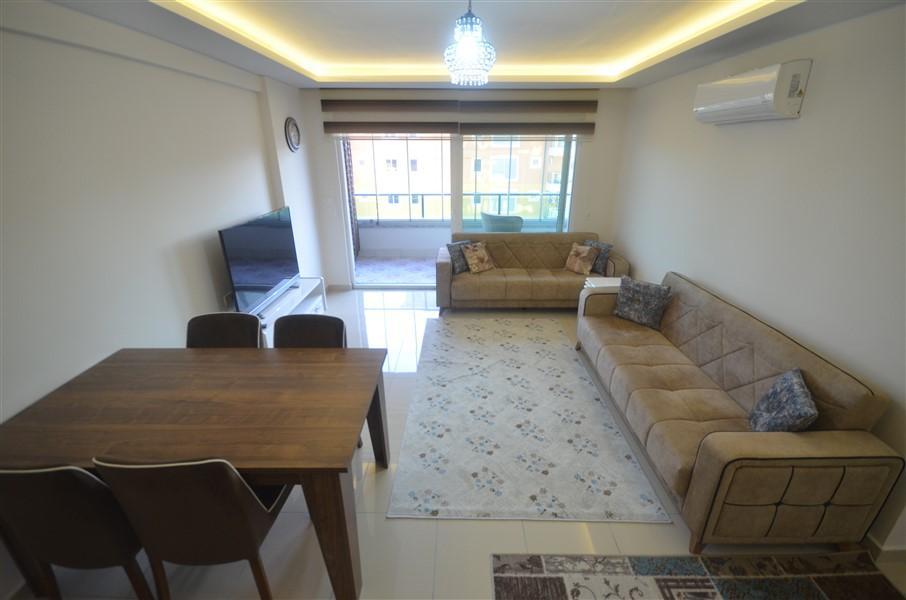 Просторная меблированная квартира 1+1 в Махмутларе в 250 метрах от моря - Фото 2