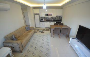 Просторная меблированная квартира 1+1 в Махмутларе в 250 метрах от моря