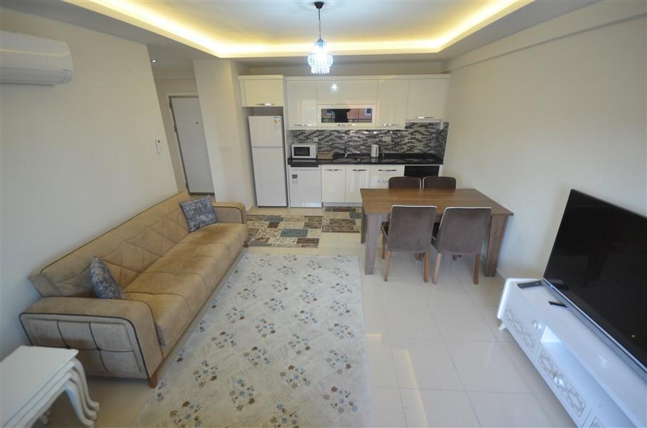 Просторная меблированная квартира 1+1 в Махмутларе в 250 метрах от моря - Фото 1