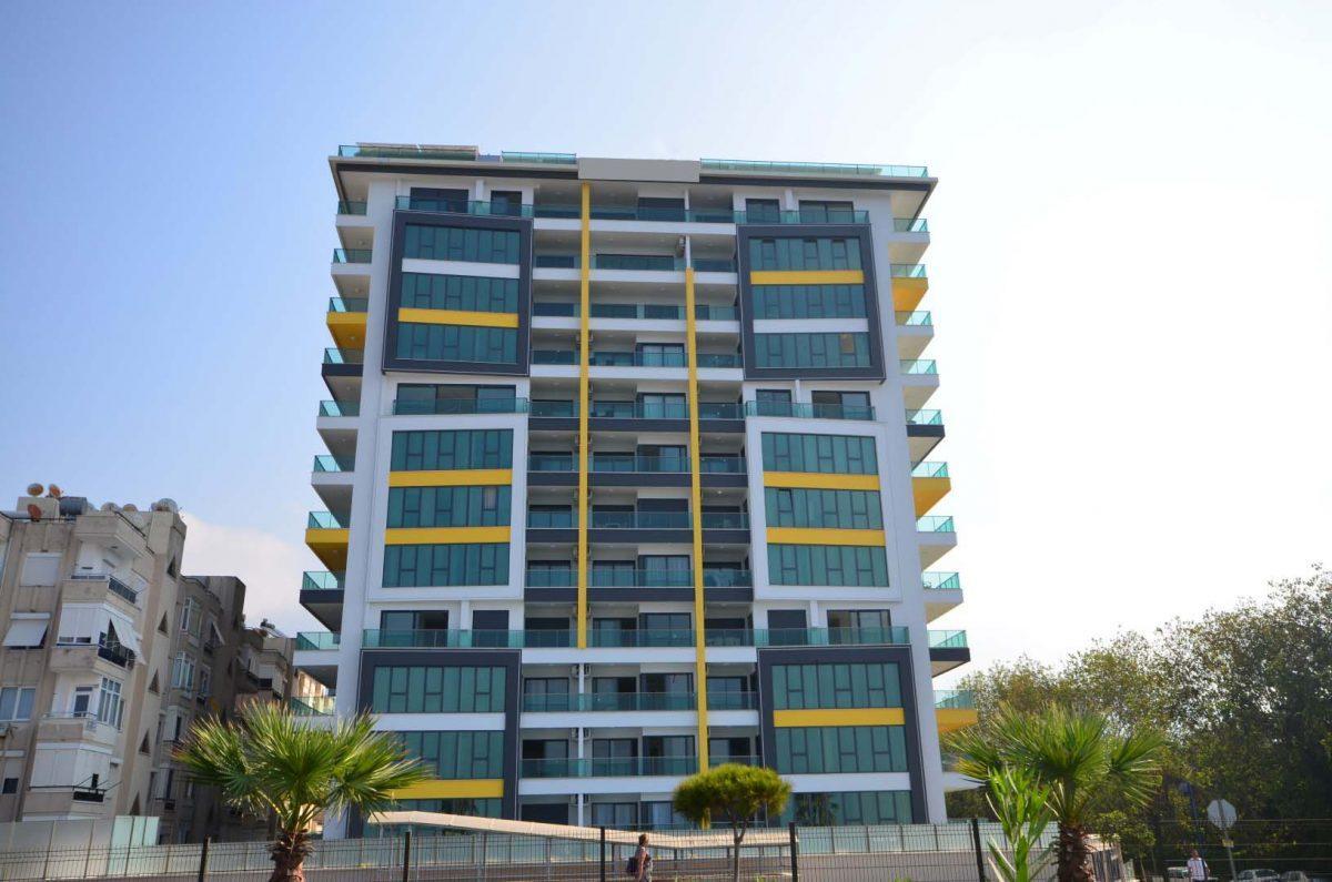 Жилой комплекс в самом центре района Махмутлар и в 50 метрах от моря - Фото 1