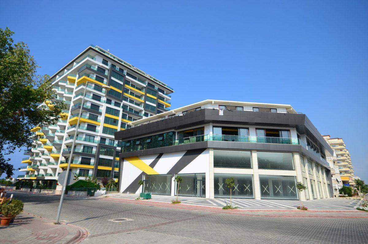Жилой комплекс в самом центре района Махмутлар и в 50 метрах от моря - Фото 3