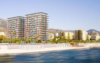 Новая квартира 2+1 на первой береговой линии в Махмутларе