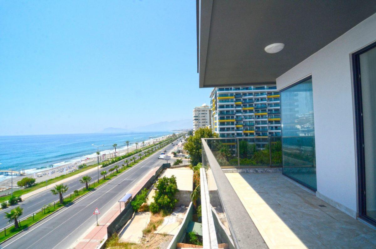 Новая квартира 2+1 на первой береговой линии в Махмутларе - Фото 18