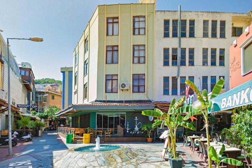 Жилой комплекс с коммерческими помещения с уникальной локацией в центре Алании - Фото 1