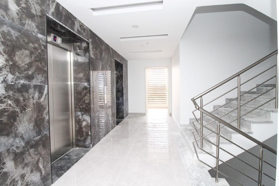 Новая квартира 2+1 на первой береговой линии в Махмутларе - Фото 13
