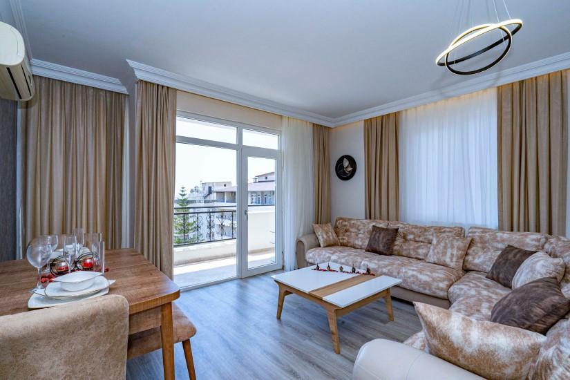 Двухкомнатные апартаменты на высоком этаже в центре Алании - Фото 15
