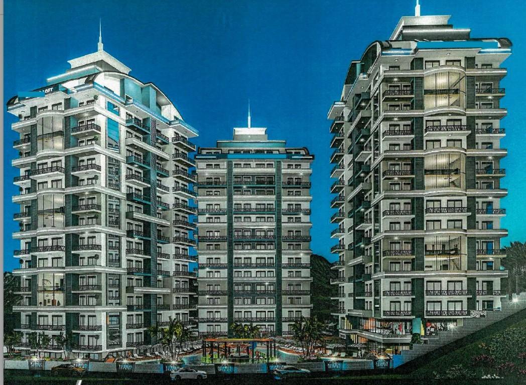 Апартаменты 1+1 в строящемся комплексе в Махмутларе - Фото 1