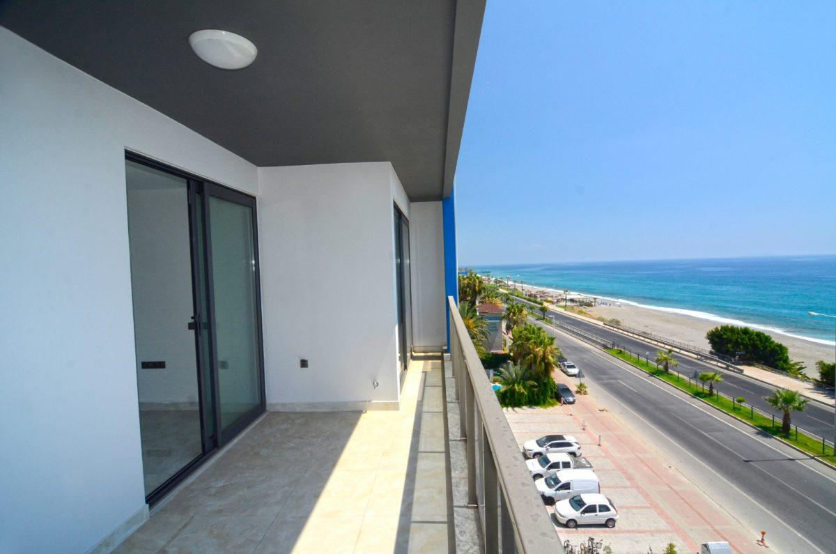 Новая квартира 2+1 на первой береговой линии в Махмутларе - Фото 19