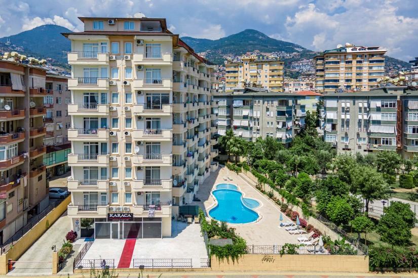 Двухкомнатные апартаменты на высоком этаже в центре Алании - Фото 1
