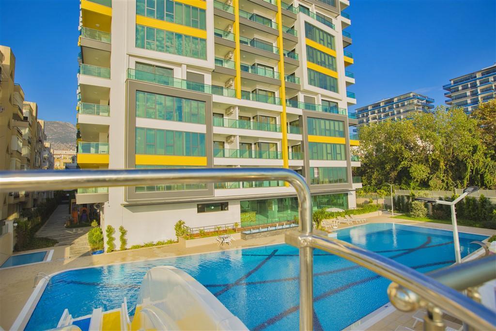 Двухкомнатные апартаменты на первой береговой линии в Махмутларе - Фото 3