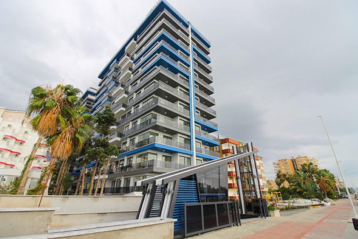 Новая квартира 2+1 на первой береговой линии в Махмутларе - Фото 3