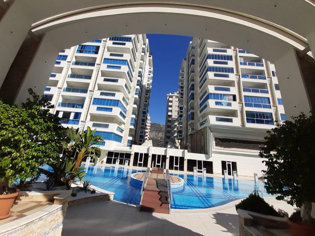 Просторные апартаменты 2+1 в новом комплексе в Махмутларе - Фото 2