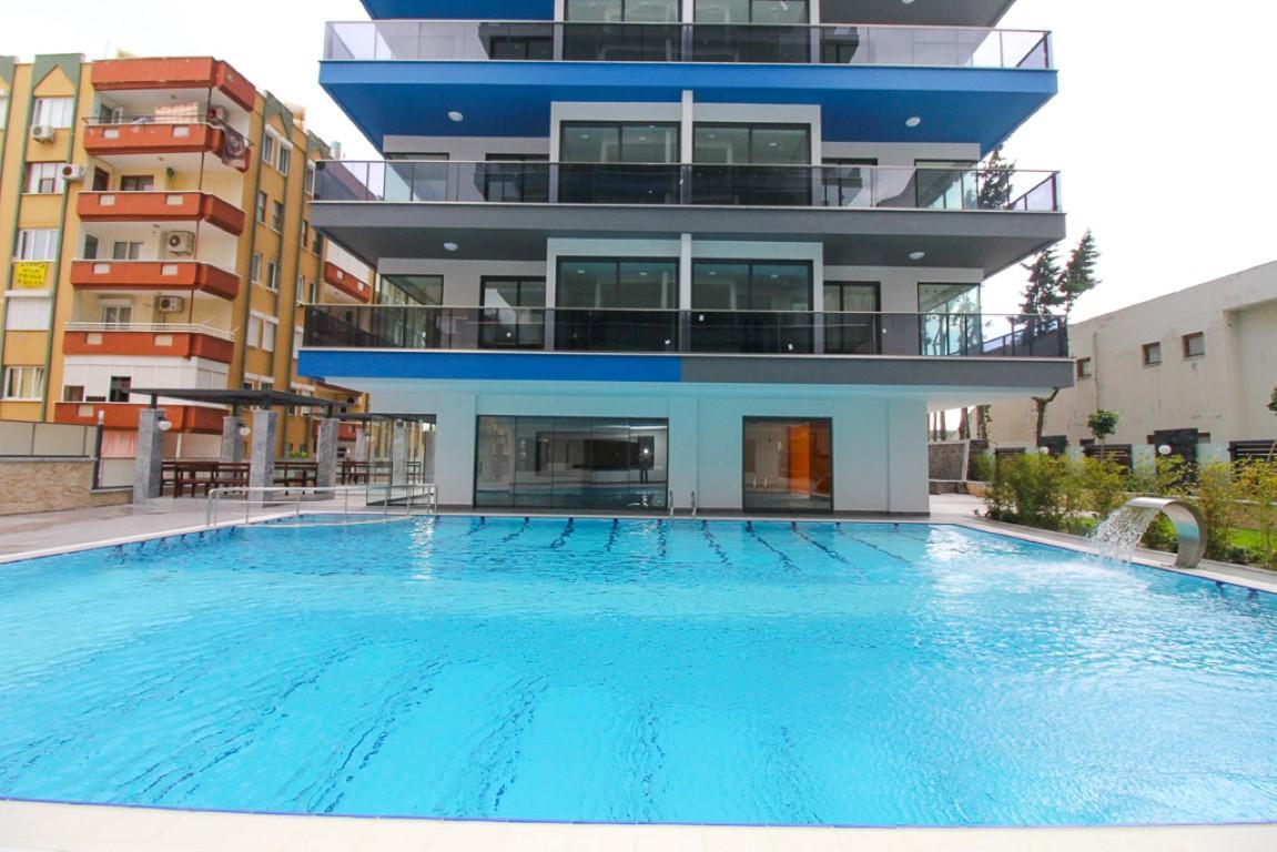 Новая квартира 2+1 на первой береговой линии в Махмутларе - Фото 6