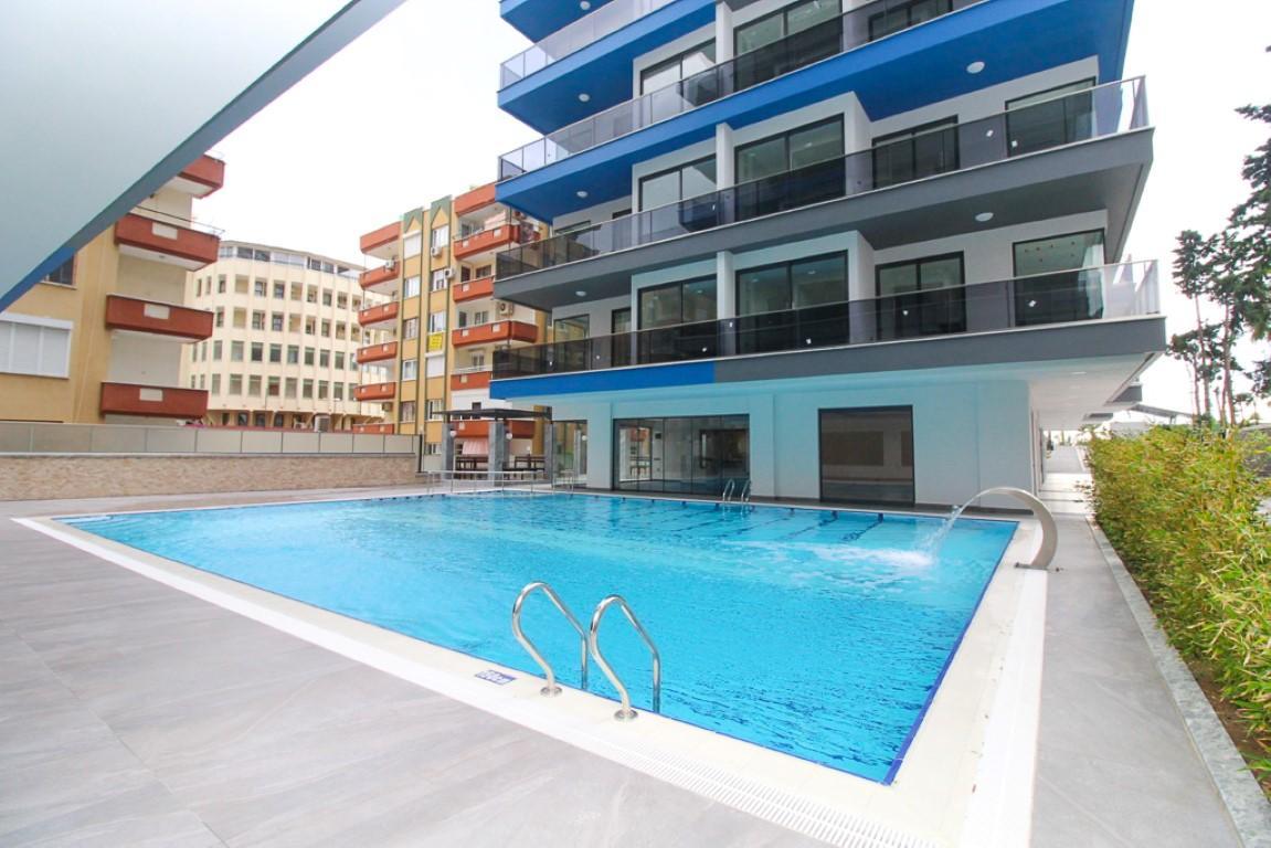 Новая квартира 2+1 на первой береговой линии в Махмутларе - Фото 7