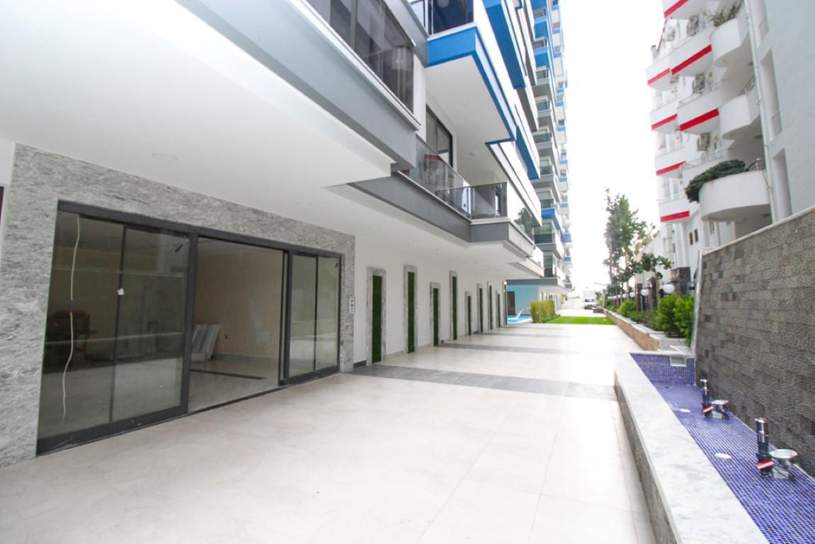 Новая квартира 2+1 на первой береговой линии в Махмутларе - Фото 8