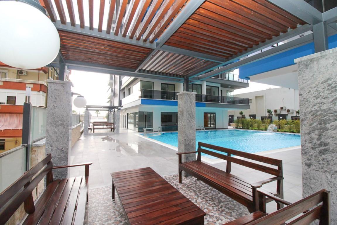 Новая квартира 2+1 на первой береговой линии в Махмутларе - Фото 9