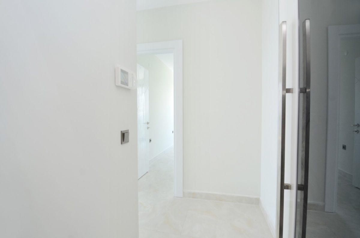 Новая квартира 2+1 на первой береговой линии в Махмутларе - Фото 12