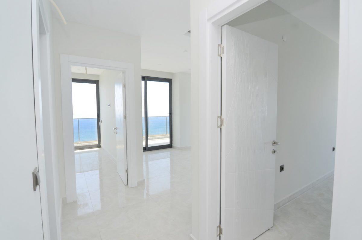Новая квартира 2+1 на первой береговой линии в Махмутларе - Фото 14