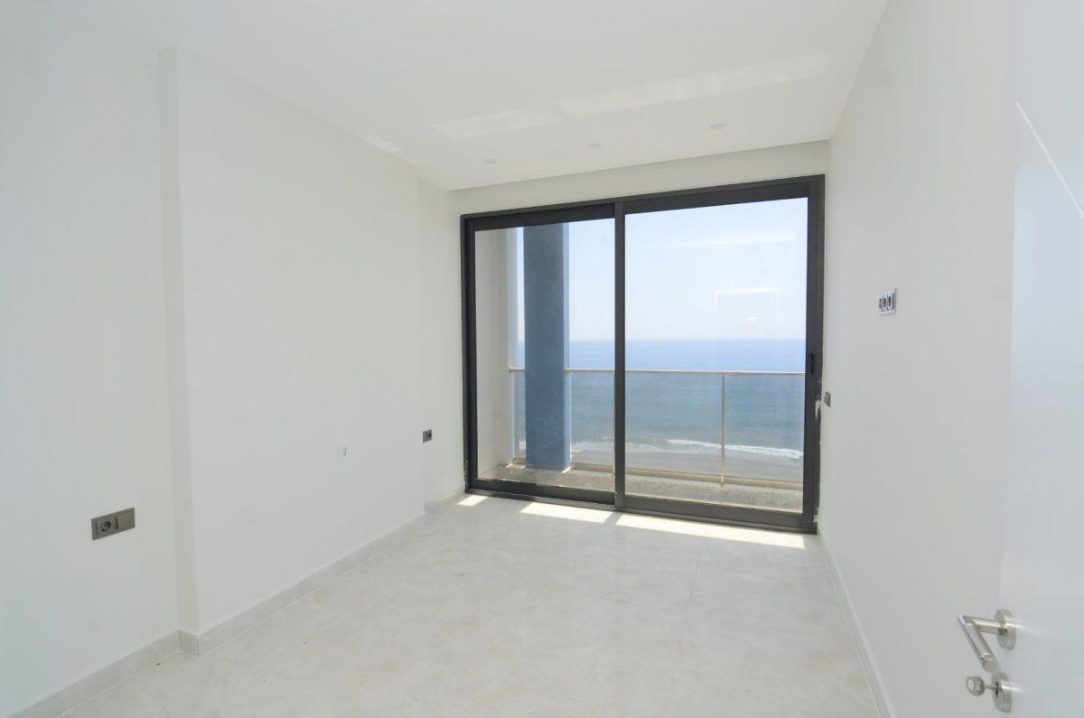 Новая квартира 2+1 на первой береговой линии в Махмутларе - Фото 15