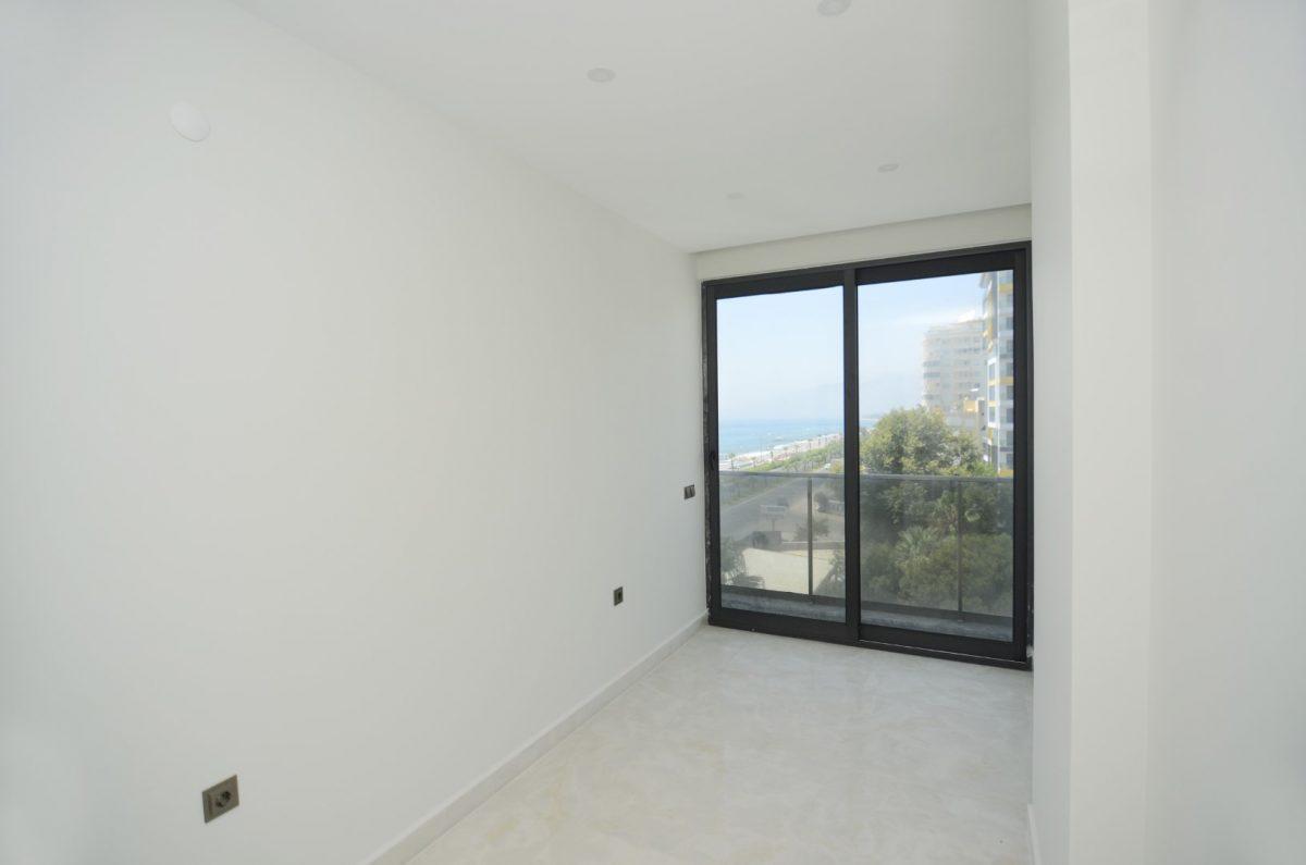 Новая квартира 2+1 на первой береговой линии в Махмутларе - Фото 16