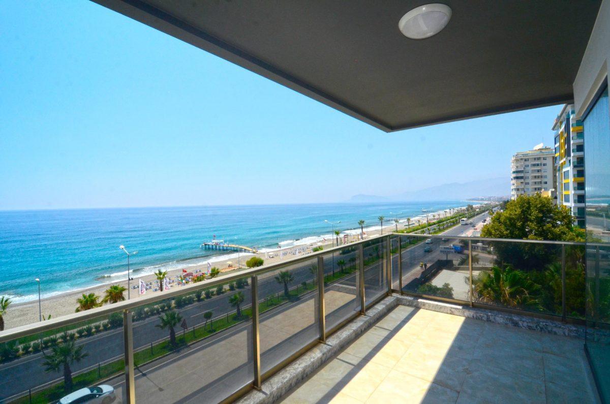 Новая квартира 2+1 на первой береговой линии в Махмутларе - Фото 17