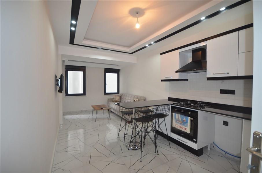 Двухкомнатные апартаменты в центре Алании по выгодной цене - Фото 1