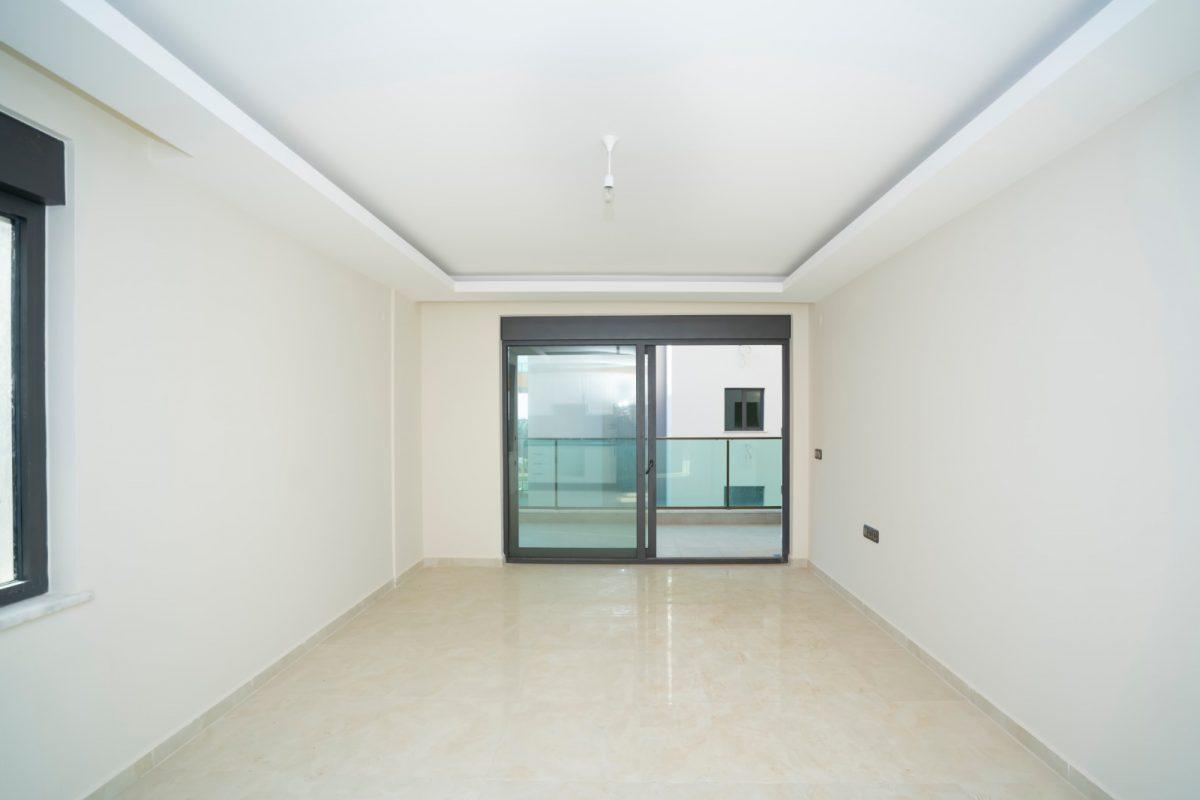 Квартира 2+1 на первой береговой линии в хорошем комплексе в Махмутларе - Фото 14