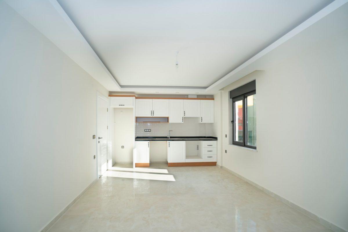 Квартира 2+1 на первой береговой линии в хорошем комплексе в Махмутларе - Фото 15
