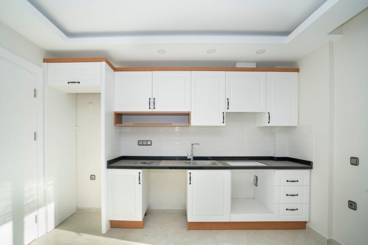Квартира 2+1 на первой береговой линии в хорошем комплексе в Махмутларе - Фото 17