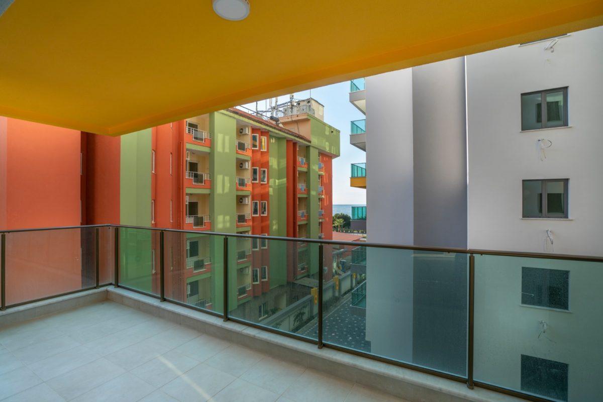 Квартира 2+1 на первой береговой линии в хорошем комплексе в Махмутларе - Фото 27