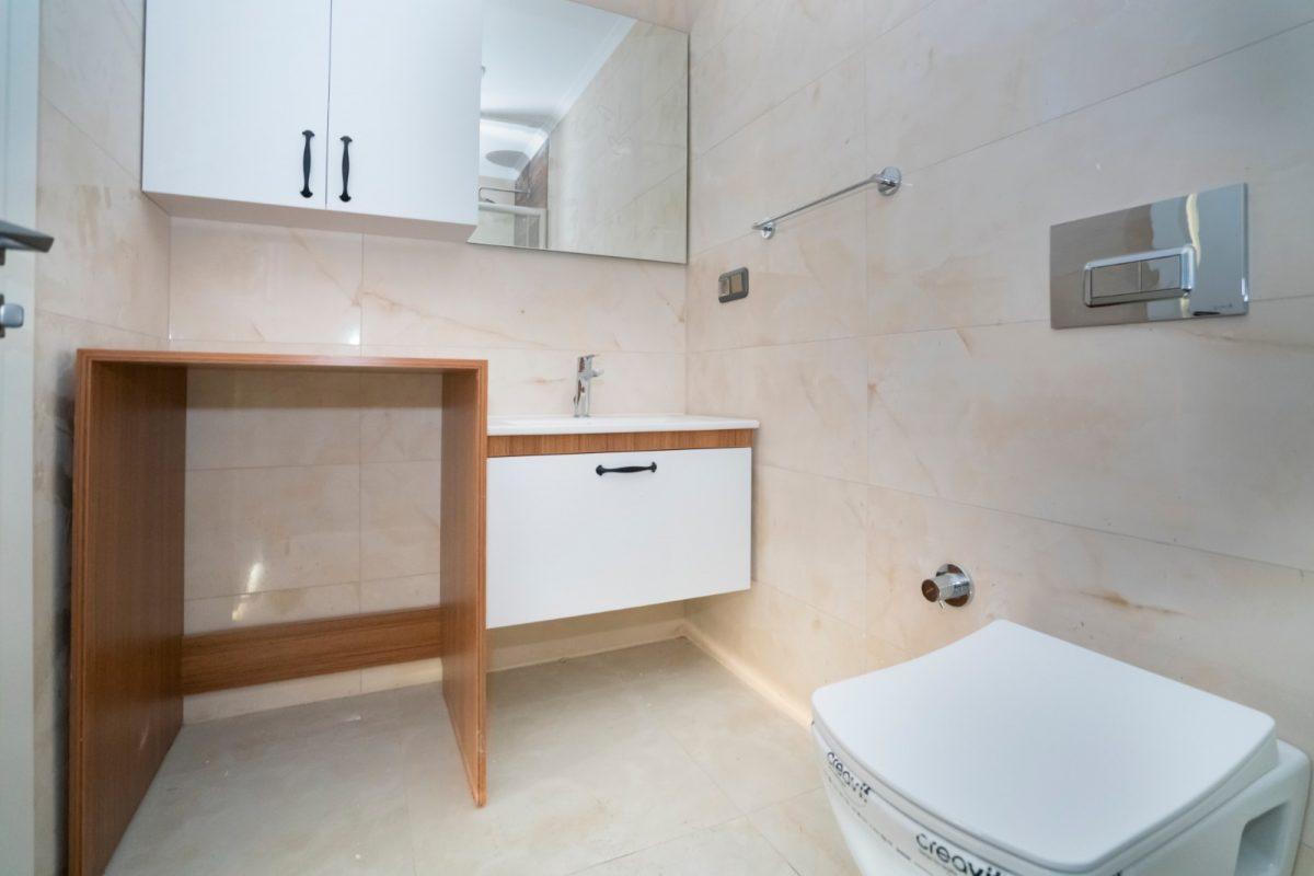 Квартира 2+1 на первой береговой линии в хорошем комплексе в Махмутларе - Фото 22