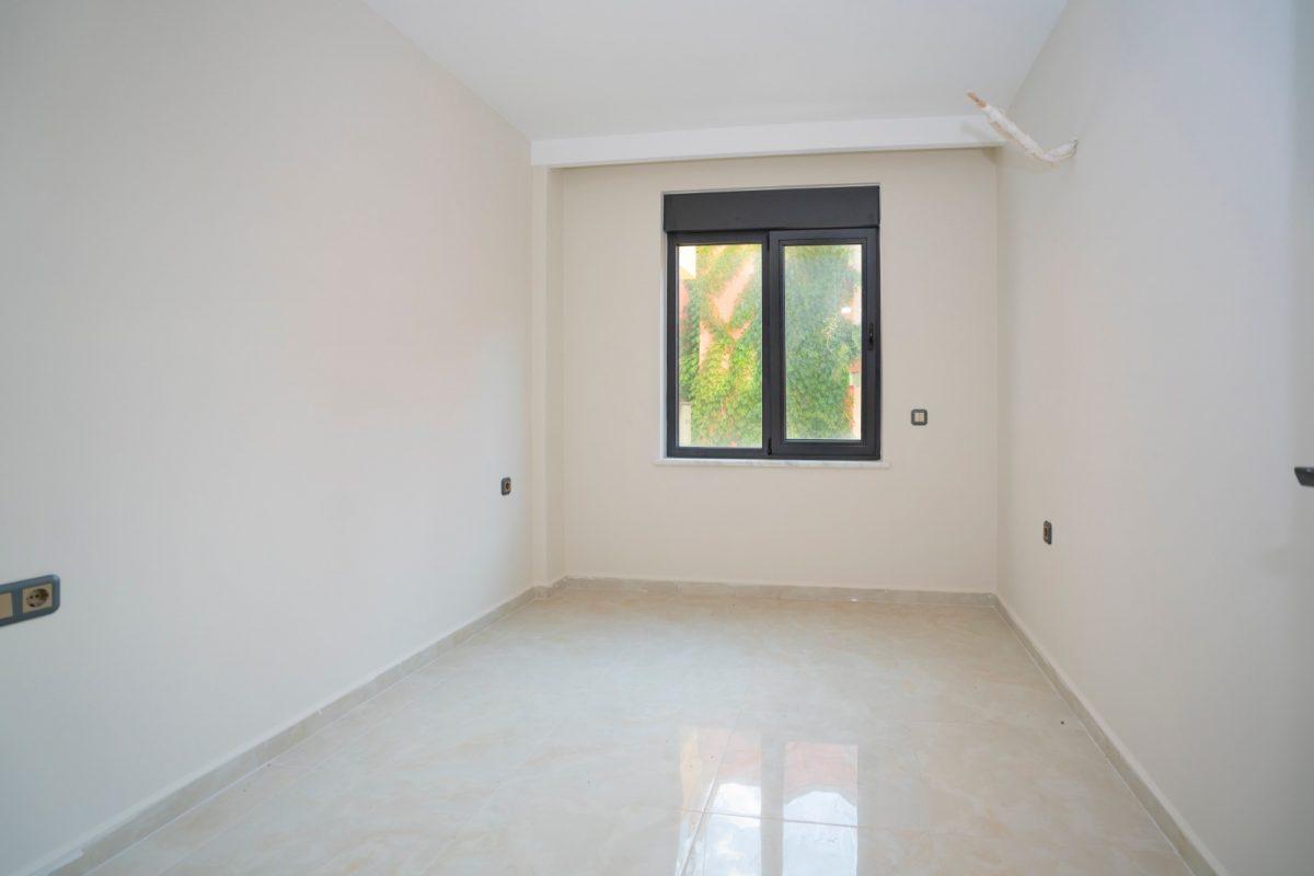 Квартира 2+1 на первой береговой линии в хорошем комплексе в Махмутларе - Фото 23