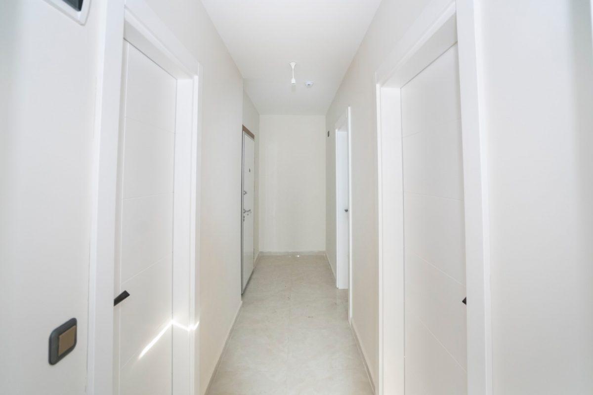 Квартира 2+1 на первой береговой линии в хорошем комплексе в Махмутларе - Фото 24