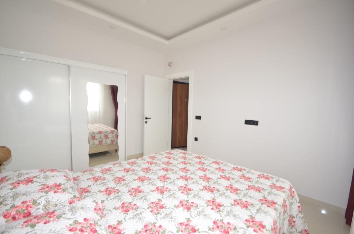 Квартира по доступной цене 1+1 в комплексе в Махмутлар - Фото 17
