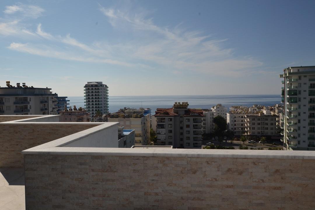 Просторный дуплекс с видом на море в Махмутларе - Фото 39