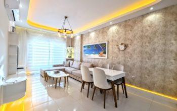 Стильная меблированная квартира в шаговой доступности от моря 1+1 в Махмутлар