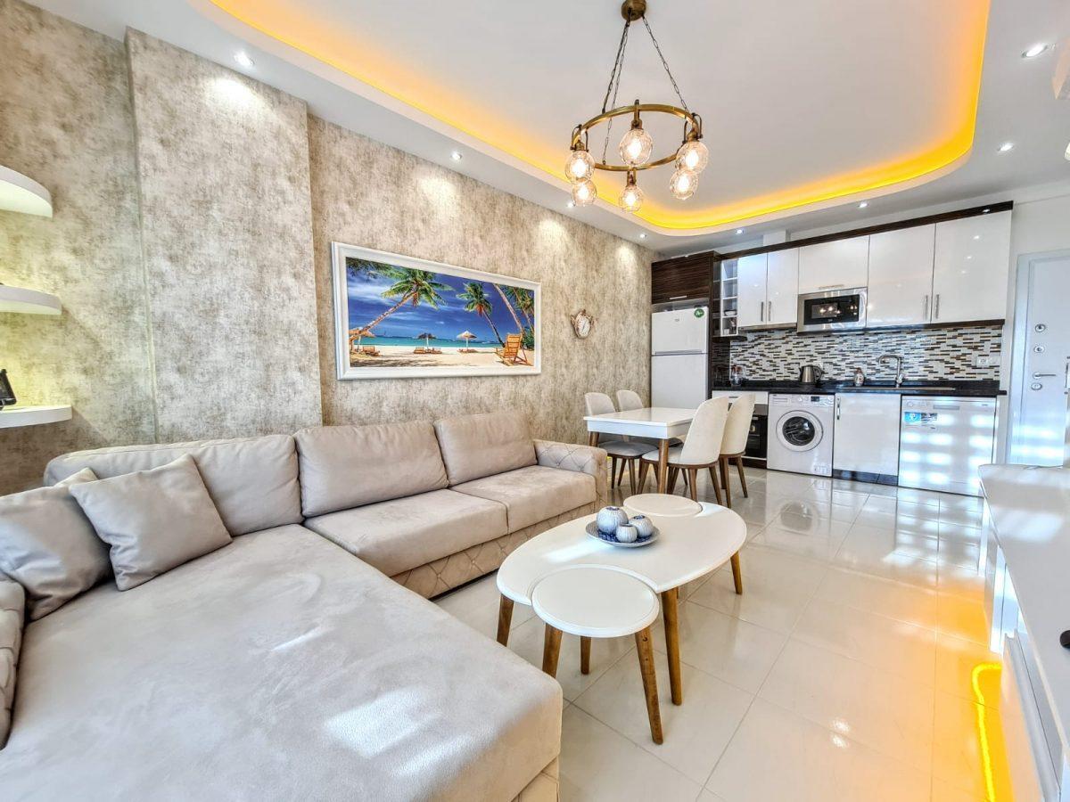 Стильная меблированная квартира в шаговой доступности от моря 1+1 в Махмутлар - Фото 6