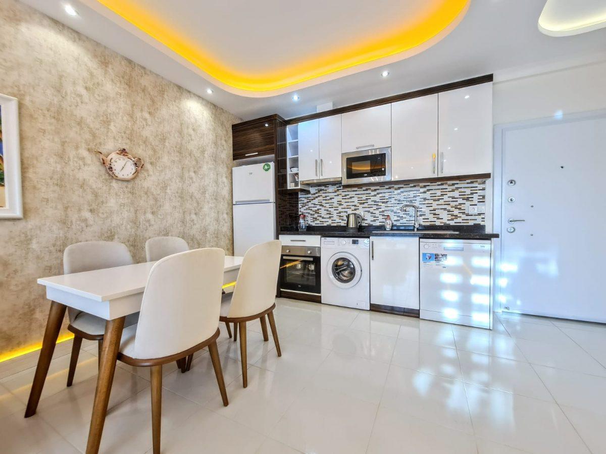 Стильная меблированная квартира в шаговой доступности от моря 1+1 в Махмутлар - Фото 8