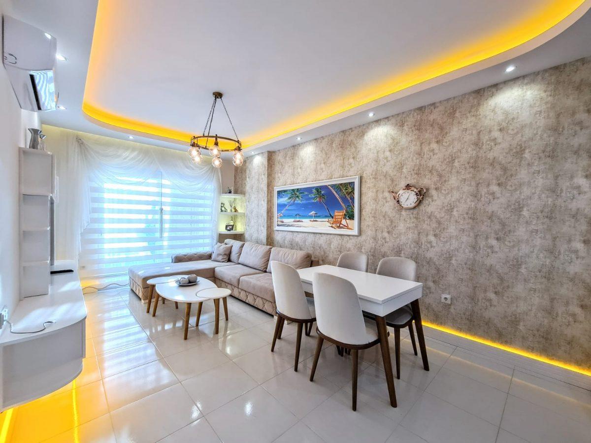 Стильная меблированная квартира в шаговой доступности от моря 1+1 в Махмутлар - Фото 7