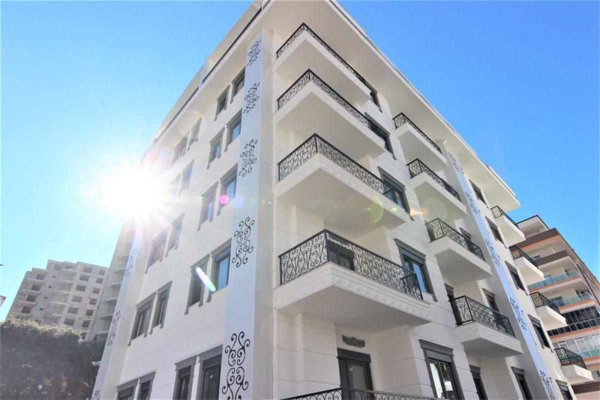 Новые светлые апартаменты 1+1 в Махмутлар - Фото 1