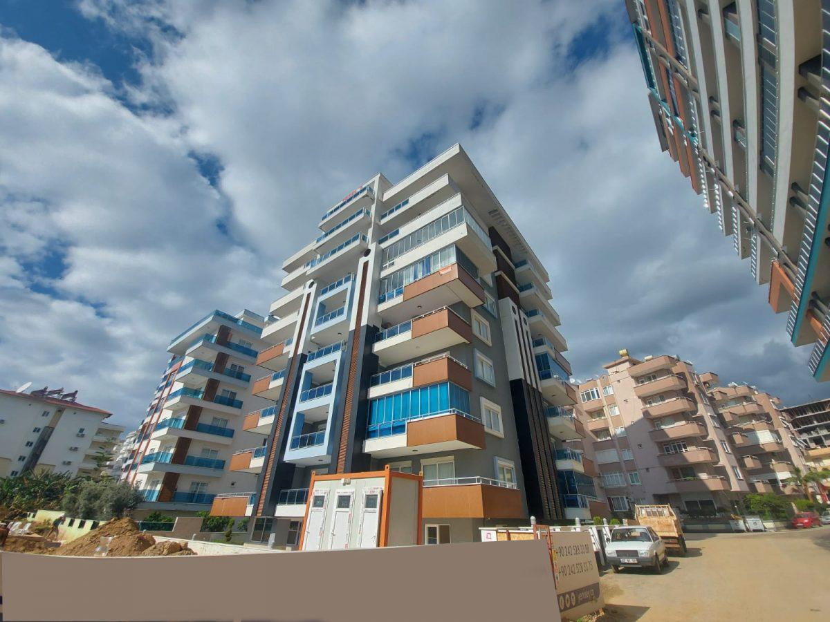Новые апартаменты 1+1 в спокойной части Махмутлара - Фото 2