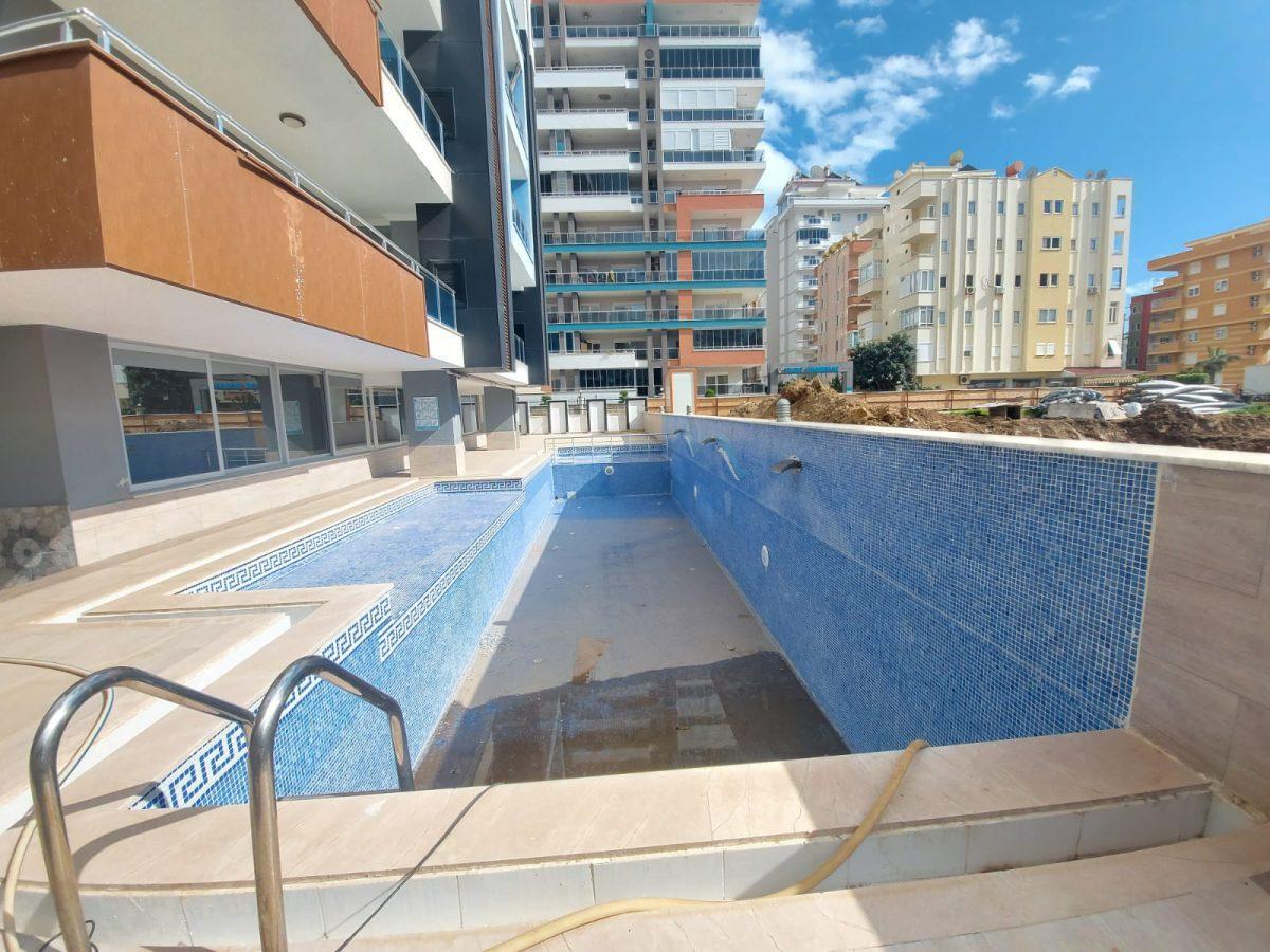 Новые апартаменты 1+1 в спокойной части Махмутлара - Фото 13