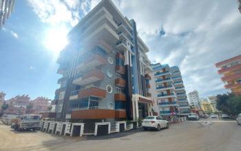 Новые апартаменты 1+1 в спокойной части Махмутлара
