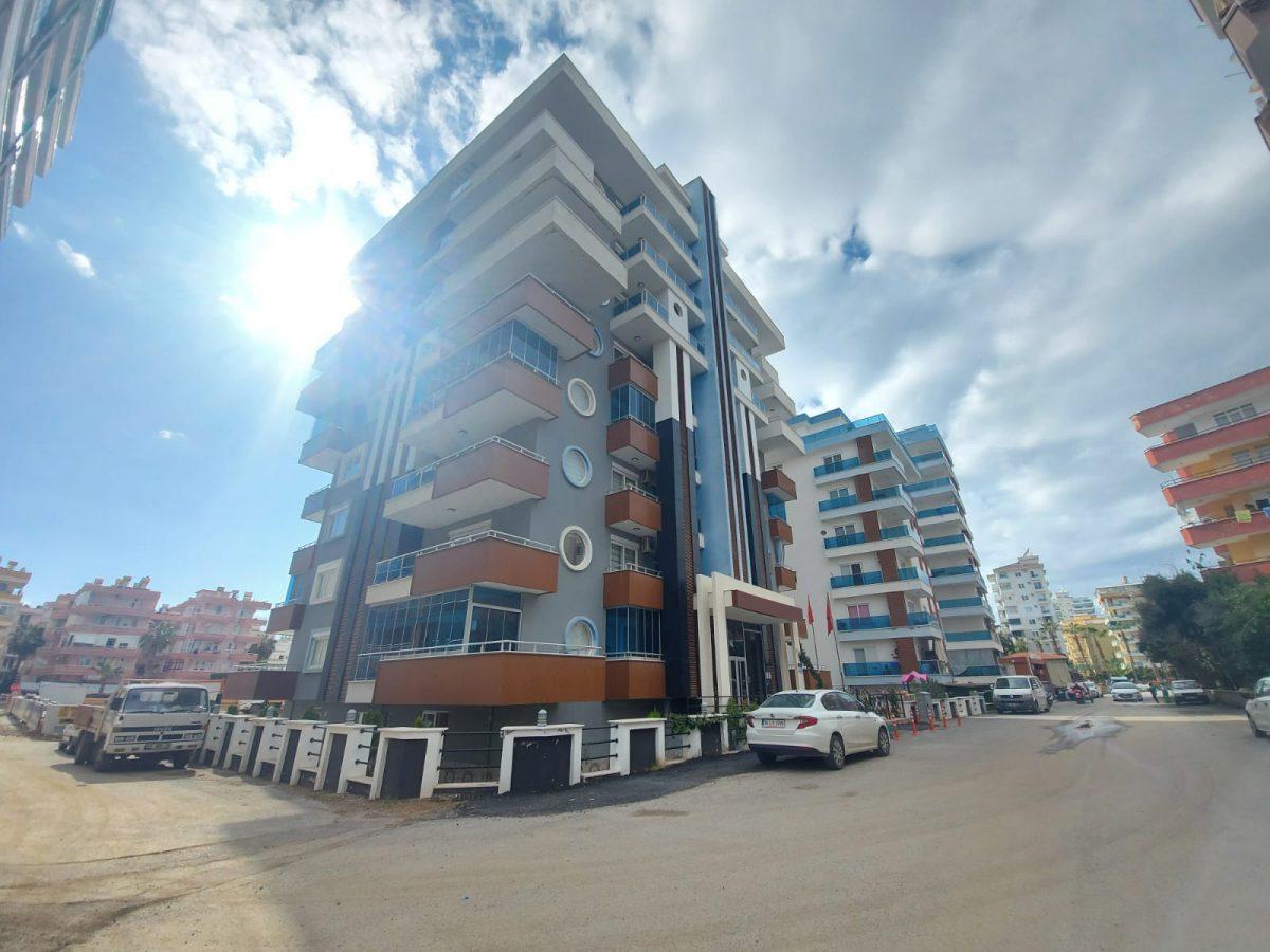 Новые апартаменты 1+1 в спокойной части Махмутлара - Фото 1